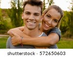 portrait of a happy young... | Shutterstock . vector #572650603