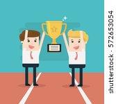 two businessmen holding gold... | Shutterstock .eps vector #572653054