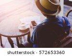 hand woman using smartphone in... | Shutterstock . vector #572653360