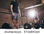 sporty man and woman preparing... | Shutterstock . vector #572684164