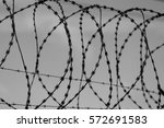 Fence With Barbed Wire In Fron...
