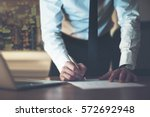 close up business man signing... | Shutterstock . vector #572692948