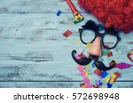 a red wig  a pair of fake black ... | Shutterstock . vector #572698948