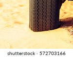An Suv\'s Flattened Tire On A...