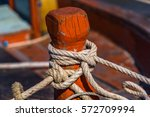 a boat moored and secured by... | Shutterstock . vector #572709994