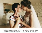 happy mother holds bride's hand ... | Shutterstock . vector #572714149