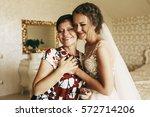 happy mother holds bride's hand ...   Shutterstock . vector #572714206