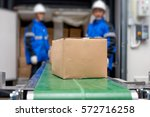 package boxes from conveyor... | Shutterstock . vector #572716258