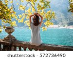 young woman relaxing on... | Shutterstock . vector #572736490