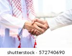 arab and business man are... | Shutterstock . vector #572740690