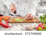 chef cooking food kitchen... | Shutterstock . vector #572749000