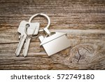 house key on a house shaped... | Shutterstock . vector #572749180