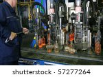 Manufacture of glass bottles - stock photo