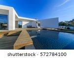modern house with garden... | Shutterstock . vector #572784100