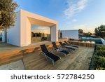 modern house with garden... | Shutterstock . vector #572784250