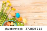 happy easter  narcissus flowers ...   Shutterstock . vector #572805118