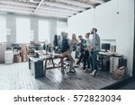 team at work. full length of... | Shutterstock . vector #572823034