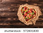 heart shaped pizza with... | Shutterstock . vector #572831830