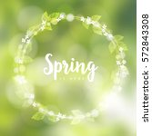 spring background with wreath... | Shutterstock .eps vector #572843308