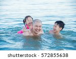 asian father and his children... | Shutterstock . vector #572855638