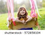 little girl on the swing ... | Shutterstock . vector #572858104