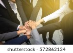 business team joining hands... | Shutterstock . vector #572862124