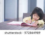 Cute Little Girl Doing Homewor...