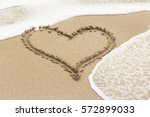 Heart Drawn On The Sand Of A...