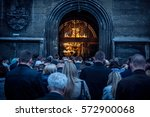 people stand outside of the... | Shutterstock . vector #572900068
