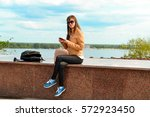 the girl with red mobile phone... | Shutterstock . vector #572923450