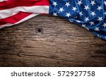 american flag on old wooden... | Shutterstock . vector #572927758