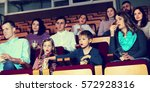 enthusiastic audience eating... | Shutterstock . vector #572928316
