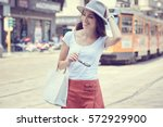 fashionably dressed woman on... | Shutterstock . vector #572929900