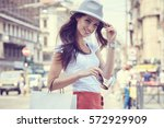fashionably dressed woman on... | Shutterstock . vector #572929909