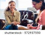 psychologist having session... | Shutterstock . vector #572937550