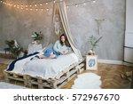 young beautiful brunette woman... | Shutterstock . vector #572967670