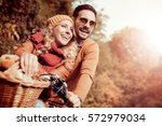 happy young couple going for a... | Shutterstock . vector #572979034