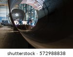 two workers welding in the... | Shutterstock . vector #572988838