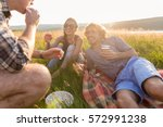 friends sitting in grass and... | Shutterstock . vector #572991238