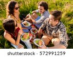 friends sitting in grass and... | Shutterstock . vector #572991259