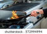 chef is roasting vegetables in... | Shutterstock . vector #572994994