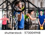 man lifting dumbbell and chain... | Shutterstock . vector #573004948
