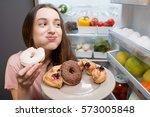 young woman in the sleepwear... | Shutterstock . vector #573005848