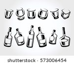whiskey bottle and glass set.... | Shutterstock .eps vector #573006454