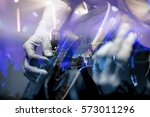 guitarist with the audience in... | Shutterstock . vector #573011296