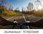 enjoying a funny bicycle... | Shutterstock . vector #573022600