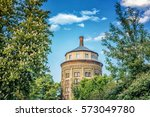 brick water tower framed by... | Shutterstock . vector #573049780