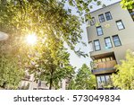 apartment house in summer sky | Shutterstock . vector #573049834