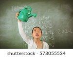 schoolgirl using a watering can ... | Shutterstock . vector #573055534