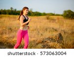young woman running on the... | Shutterstock . vector #573063004